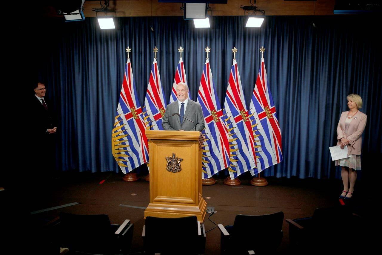 Premier John Horgan speaks as provincial health officer Dr. Bonnie Henry, right, and Health Minister Adrian Dix look on during a press conference to update on the province's fall pandemic preparedness plan at the legislature in Victoria, Wednesday, Sept. 9, 2020. THE CANADIAN PRESS/Chad Hipolito