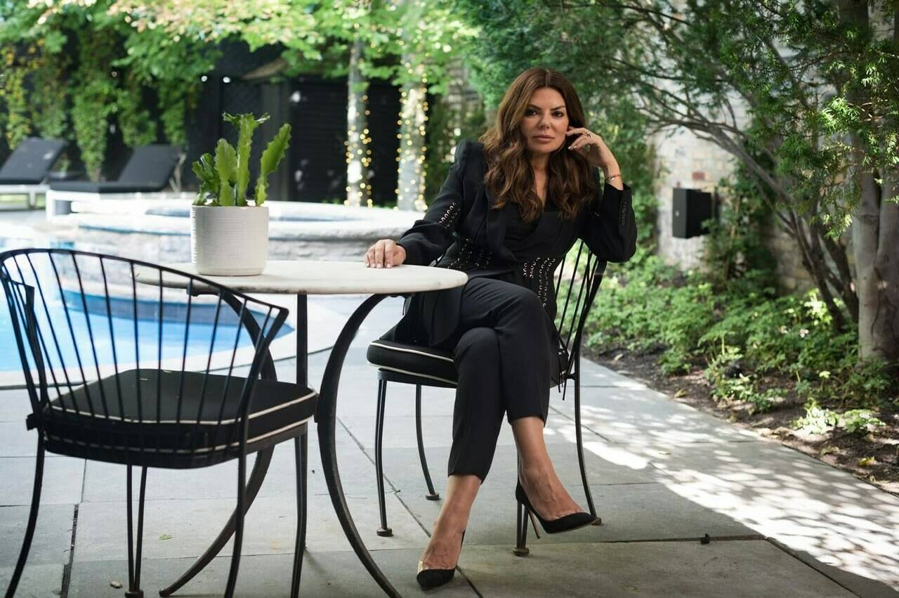 Natasha Koifman, the founder of the public relations firm NKPR, poses for a photograph in the backyard of her home in Toronto, on Thursday, August 19, 2021. When Sept. 11 comes, Koifman's backyard will be awash with chatter and music as up to 100 guests gather for an elegant dinner meant to raise funds for Haitians to access education. THE CANADIAN PRESS/ Tijana Martin