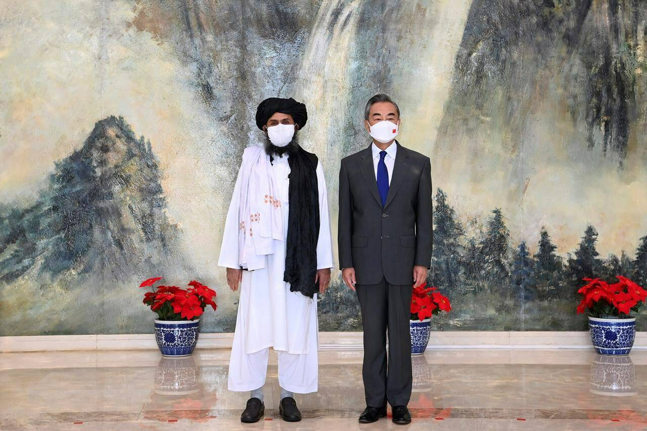 Taliban co-founder Mullah Abdul Ghani Baradar, left, and Chinese Foreign Minister Wang Yi pose for a photo during their meeting in Tianjin, China, in a July 28, 2021, photo released by China's Xinhua News Agency. With the United States and its allies, Canada included, having left Afghanistan firmly in the hands of the Taliban, another world power is stepping into the void to exert its influence on the troubled country – China. THE CANADIAN PRESS/AP-Xinhua, Li Ran