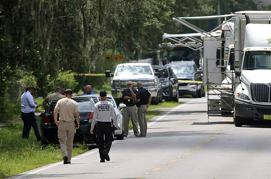Polk County, Fla., Sheriff's officials work the scene of a multiple fatality shooting Sunday, Sept. 5, 2021, in Lakeland, Fla. Four people are dead including a mother who was still cradling her now deceased baby in what Florida sheriff's deputies are calling a massive gun battle with a suspect. (Michael Wilson/The Ledger via AP)t