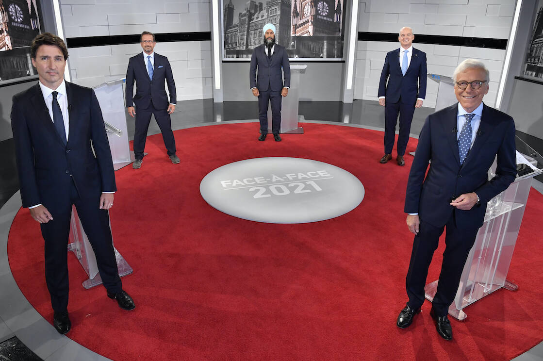 Liberal Leader Justin Trudeau, left to right, Bloc Quebecois Leader Yves-Francois Blanchet, NDP Leader Jagmeet Singh, Conservative Leader Erin O'Toole and debate moderator Pierre Bruneau pose for a photo during the first French leaders' debate on Thursday, September 2, 2021 in Montreal. THE CANADIAN PRESS/Martin Chevalier - POOL