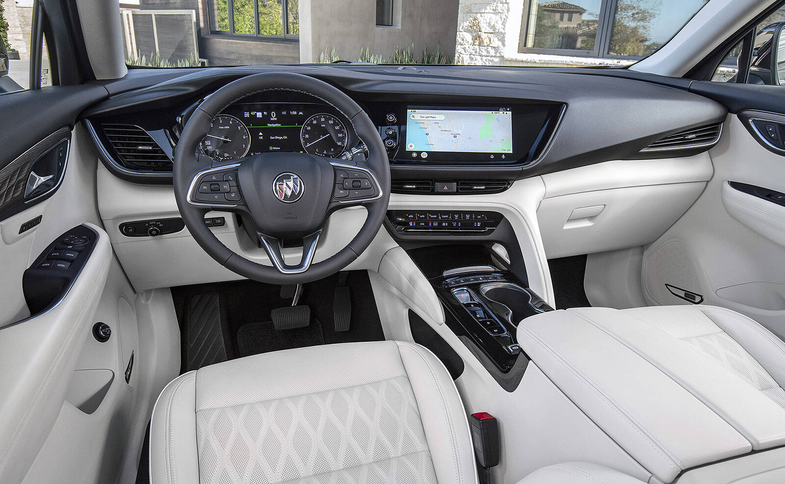 The redesigned interior replaces the shifter handle with a row of buttons, and the touch-screens are more neatly integrated into the dash. This is the inside of the new Avenir trim, but it's similar to that of the lower trims. PHOTO: GENERAL MOTORS