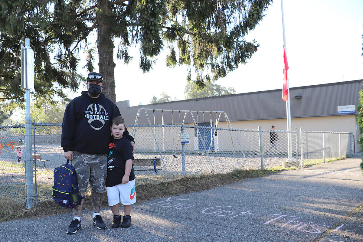 Rypien hugged dad Devon Heath before entering his first day of Grade 1 at Nicomekl Elementary on Sept. 7, 2021. (Joti Grewal/Langley Advance Times)