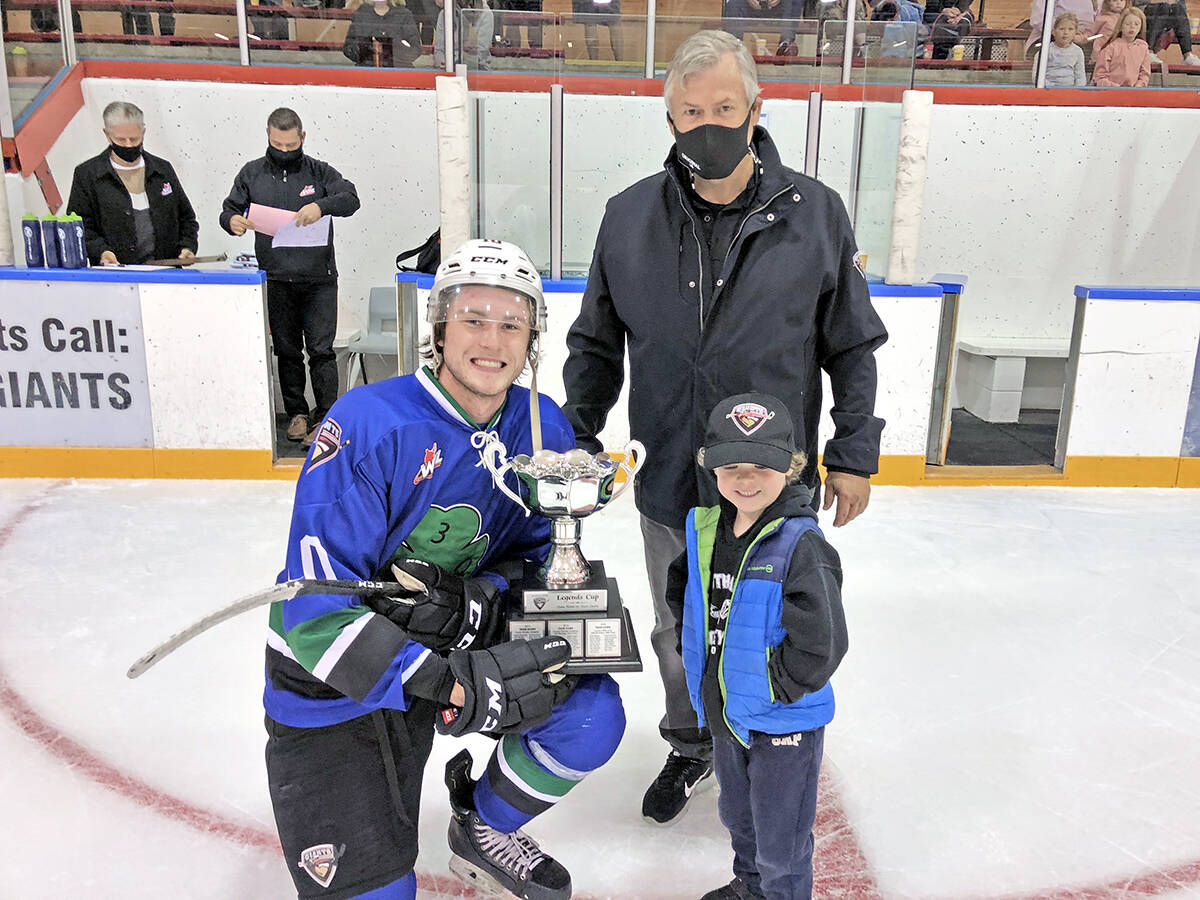 Vancouver Giants forward Zack Ostapchuk shows off the newly-won Legends Cup with Giants Senior Vice-President Dale Saip and his grandson Casey Dyck Monday, Sept. 6, at the Ladner Leisure Centre. (Special to Langley Advance Times)