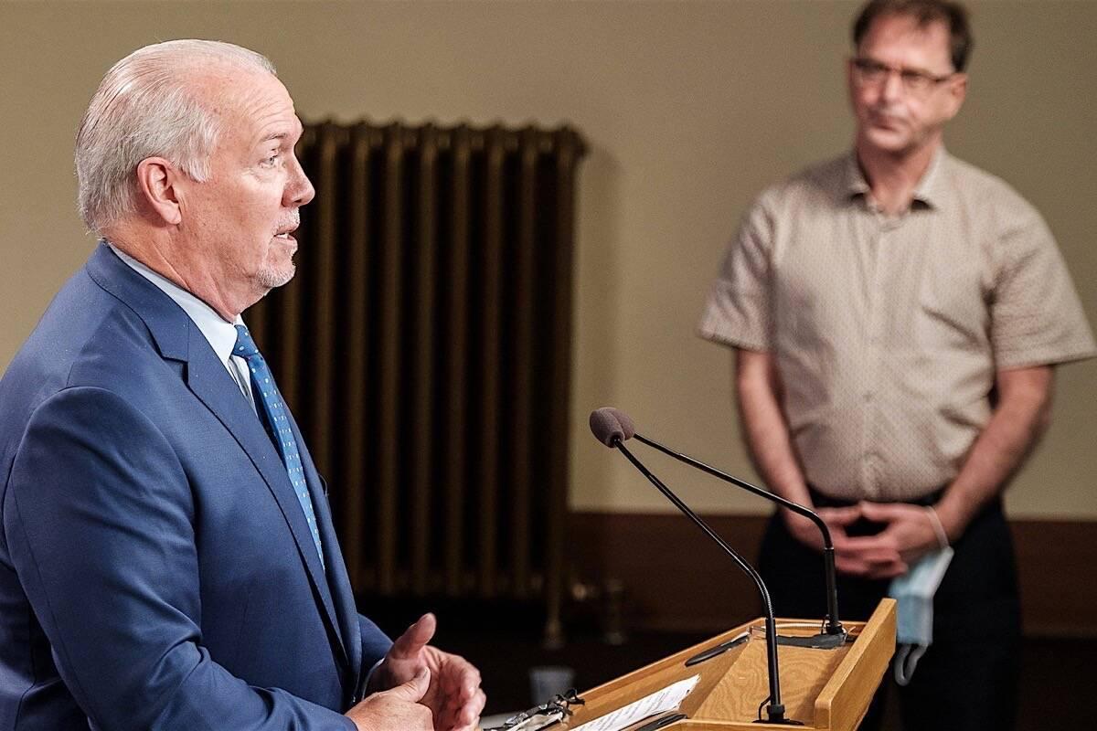 B.C. Premier John Horgan and Health Minister Adrian Dix announce vaccine card program at the B.C. legislature, Aug. 23, 2021. (B.C. government photo)
