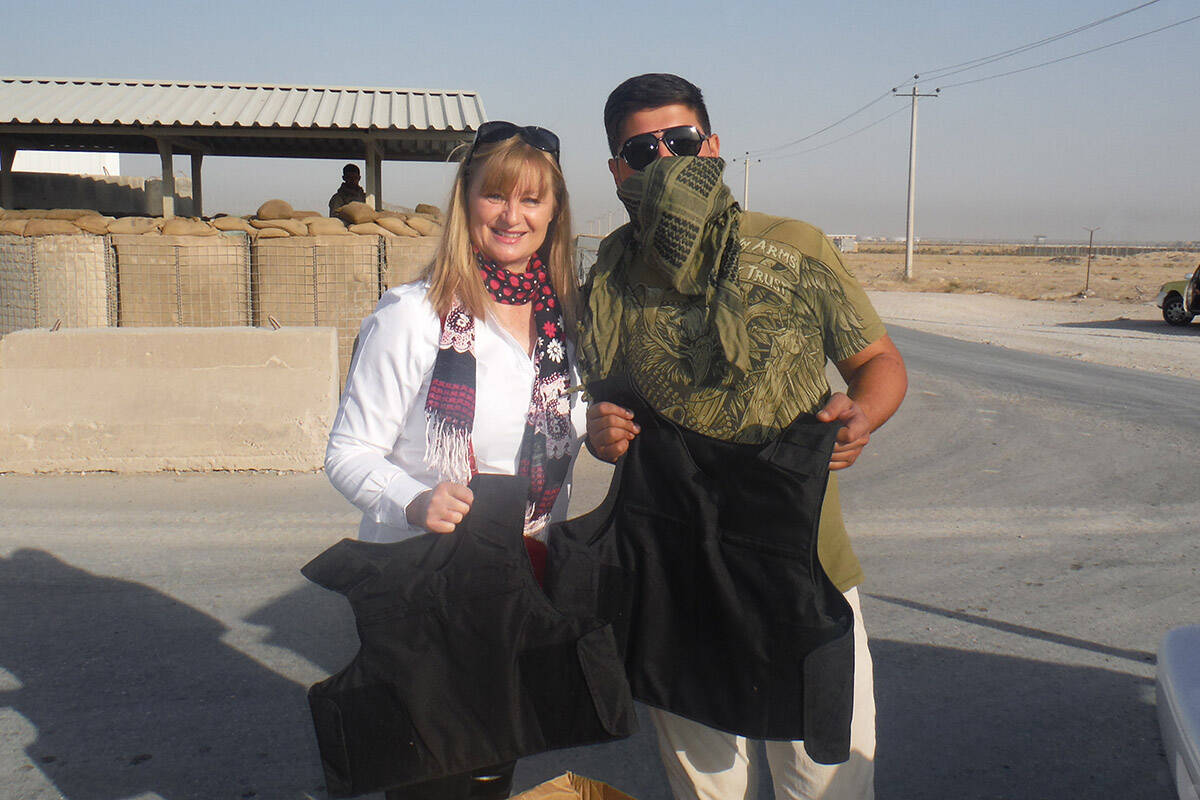 Film maker Alison MacLean with one of the many 'fixers' who helped her during her years in Afghanistan, at Camp Marmal in Mazar E Sharif while she was in a media embed with German and US troops. (Contributed photo)