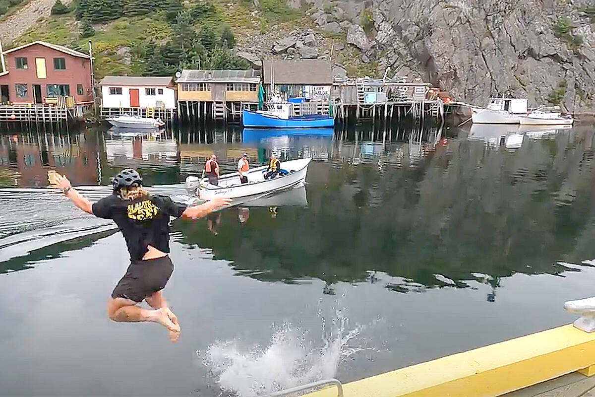 Aldergrove's Zach Choboter stripped off his roller blades, and along with his sister Rachel, jumped into the Atlantic Ocean when he wrapped up his cross-country Blading for Bees tour recently. (Special to Black Press Media)