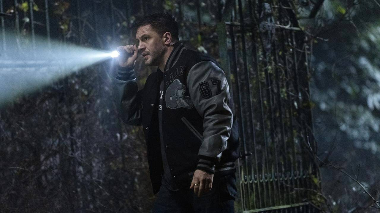 """This image released by Sony Pictures shows Tom Hardy in a scene from """"Venom: Let There Be Carnage,"""" releasing Oct. 1. (Jay Maidment/Sony Pictures Entertainment via AP)"""
