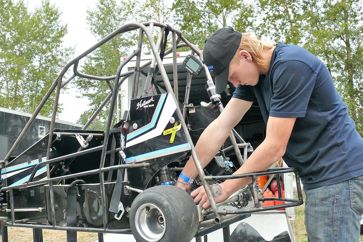 A quarter midget car gets an adjustment prior to a race at the Langley Quarter Midget Association (LQMA) on the weekend. (Dan Ferguson/Langley Advance Times)