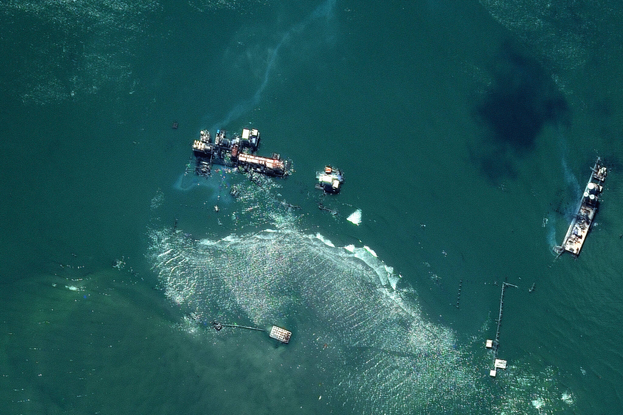 This Sept. 4, 2021, satellite image provided by Maxar shows a view of oil slicks in the Gulf of Mexico at East Timbalier Island National Wildlife Refuge in Louisiana, in the aftermath of Hurricane Ida. (Satellite image ©2021 Maxar Technologies via AP)