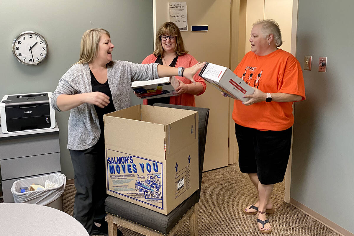 """Collette Bohach, Mardel Donnelly and Rena Andronek help pack up the offices at Ishtar Women's Resource Society as staff moved to a new space at<tcxspan tcxhref=""""tel:2232031656"""" title=""""Call 223-20316 56 with 3CX Click to Call""""> 223-20316 56 </tcxspan>Ave. (Joti Grewal/Langley Advance Times)"""
