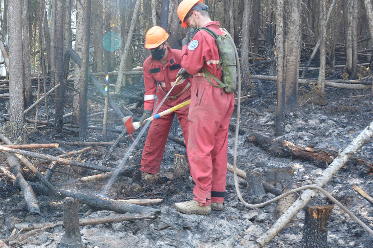 BC Wildfire crews put out hot spots on Thomas Creek Fire during summer 2021. (File photo)