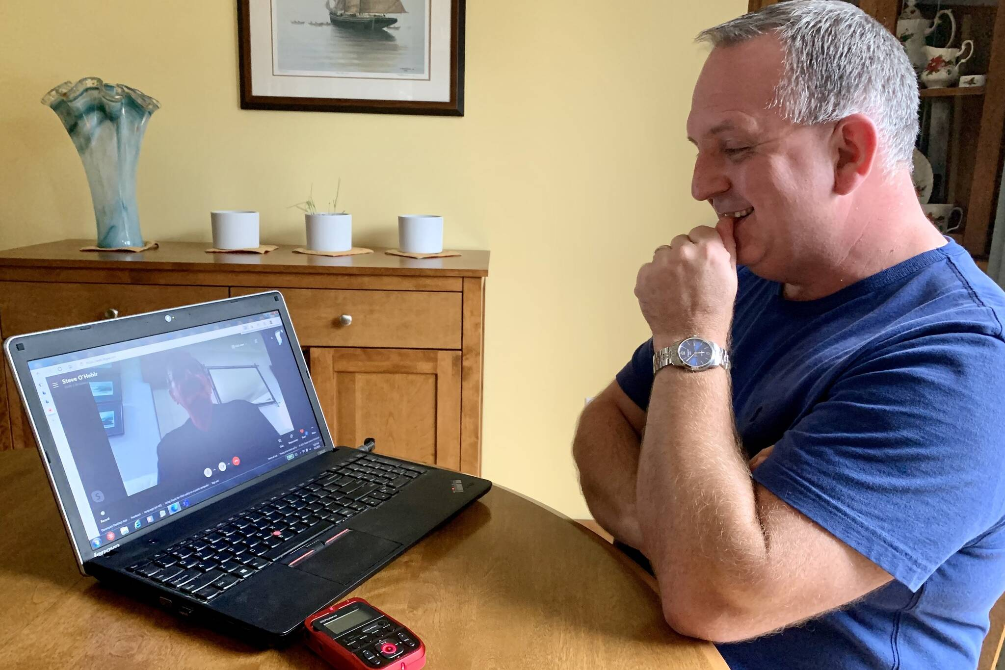 Steven Badcock chuckles at his friend in England, Steve O'Hehir, with whom he chats each week via video, in Gambo, N.L., on Friday, Sept. 3, 2021. The two met when O'Hehir's plane to Cincinnati was rerouted to Gander, N.L., on Sept. 11, 2001, and they've been close friends ever since. THE CANADIAN PRESS/Sarah Smellie