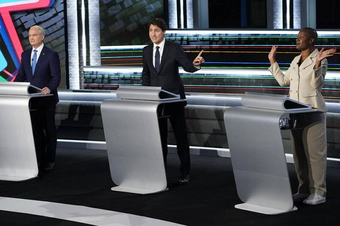 Conservative leader Erin O'Toole listens as Liberal leader Justin Trudeau and Green leader Annamie Paul discuss a point during the federal election French-language leaders debate, Wednesday, September 8, 2021 in Gatineau, Que. THE CANADIAN PRESS/Sean Kilpatrick