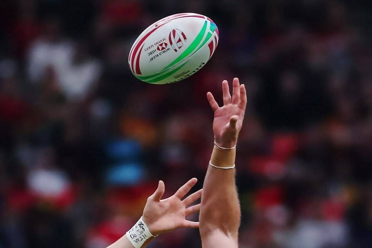 Canada's Jake Thiel, left, jumps for the ball against Australia's Nick Malouf during the Challenge Trophy final at the World Rugby Sevens Series action in Vancouver, B.C., March 10, 2019. Only seven of the men's core teams are taking part in next week's HSBC Canada Sevens in Vancouver with New Zealand. Fiji, Australia, Argentina, Japan, France and Samoa among those missing. THE CANADIAN PRESS/Ben Nelms