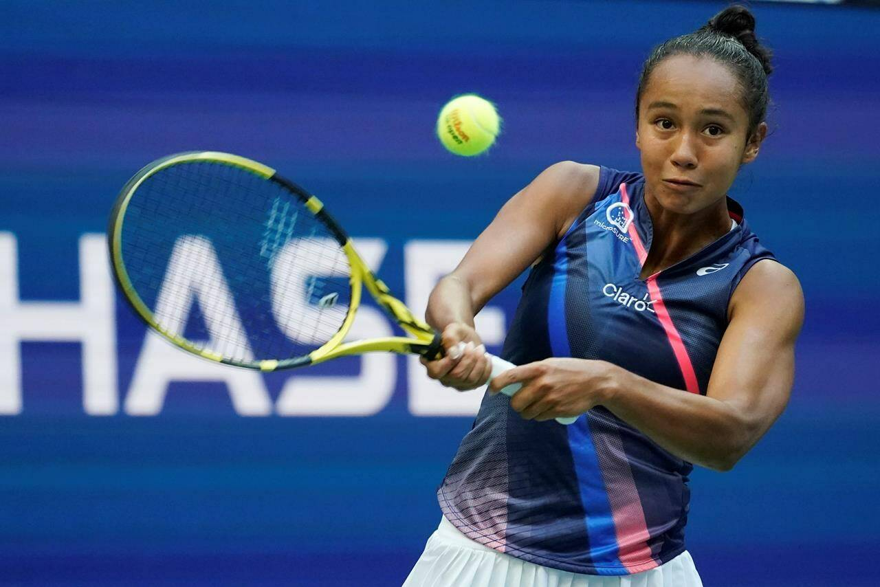 Leylah Fernandez, of Canada, returns a shot to Emma Raducanu, of Britain, during the women's singles final of the US Open tennis championships, Saturday, Sept. 11, 2021, in New York. (AP Photo/Elise Amendola)