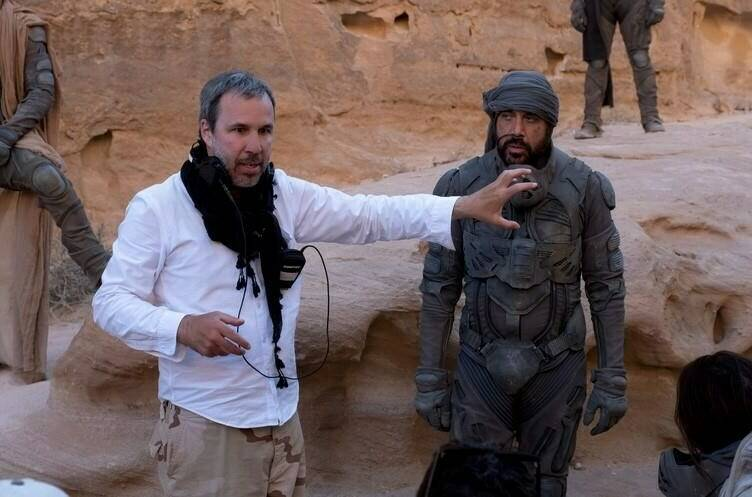 """Director Denis Villeneuve and actor Javier Bardem are shown on the set of the Warner Bros. Pictures and Legendary Pictures' action """"Dune,"""" in a handout photo. The Montreal writer-director has made headlines lately for trumpeting the importance of the cinematic experience and saying he hopes audiences will watch his sci-fi epic """"Dune"""" in theatres. THE CANADIAN PRESS/HO-Warner Bros. Entertainment Inc.-Chiabella James **MANDATORY CREDIT**"""