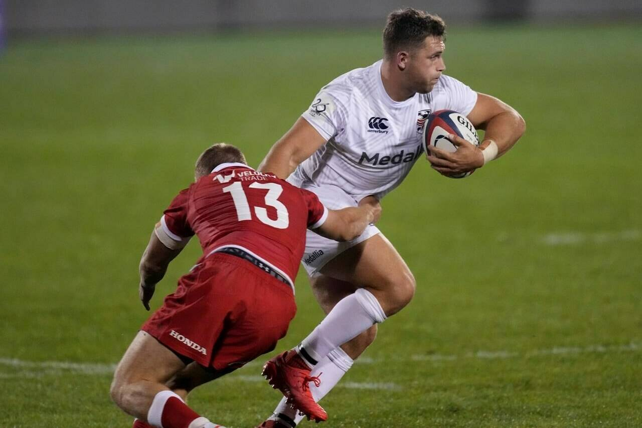 Canada back Ben LaSage, left, tries to tackle U.S. center Bryce Campbell during the first half of a Rugby World Cup 2023 qualification pathway match Saturday, Sept. 11, 2021, in Glendale, Colo. THE CANADIAN PRESS/AP, David Zalubowski