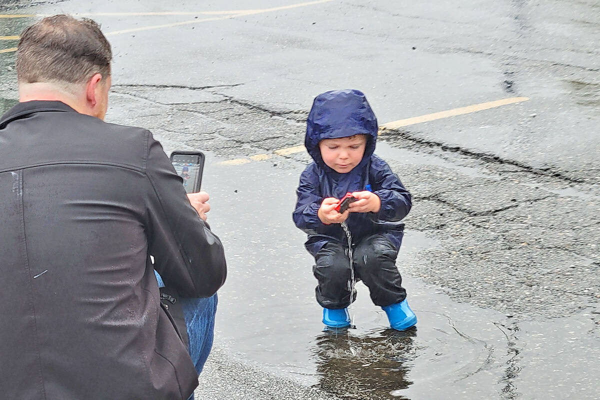 Corben, 3, from Cloverdale, was having fun in a puddle as the Good Times Cruise-In swap meet and car corral got underway in the parking lot of the Aldergrove Community Secondary School at 26850 29th Avenue on Sunday morning, Sept. 12. (Dan Ferguson/Langley Advance Times)