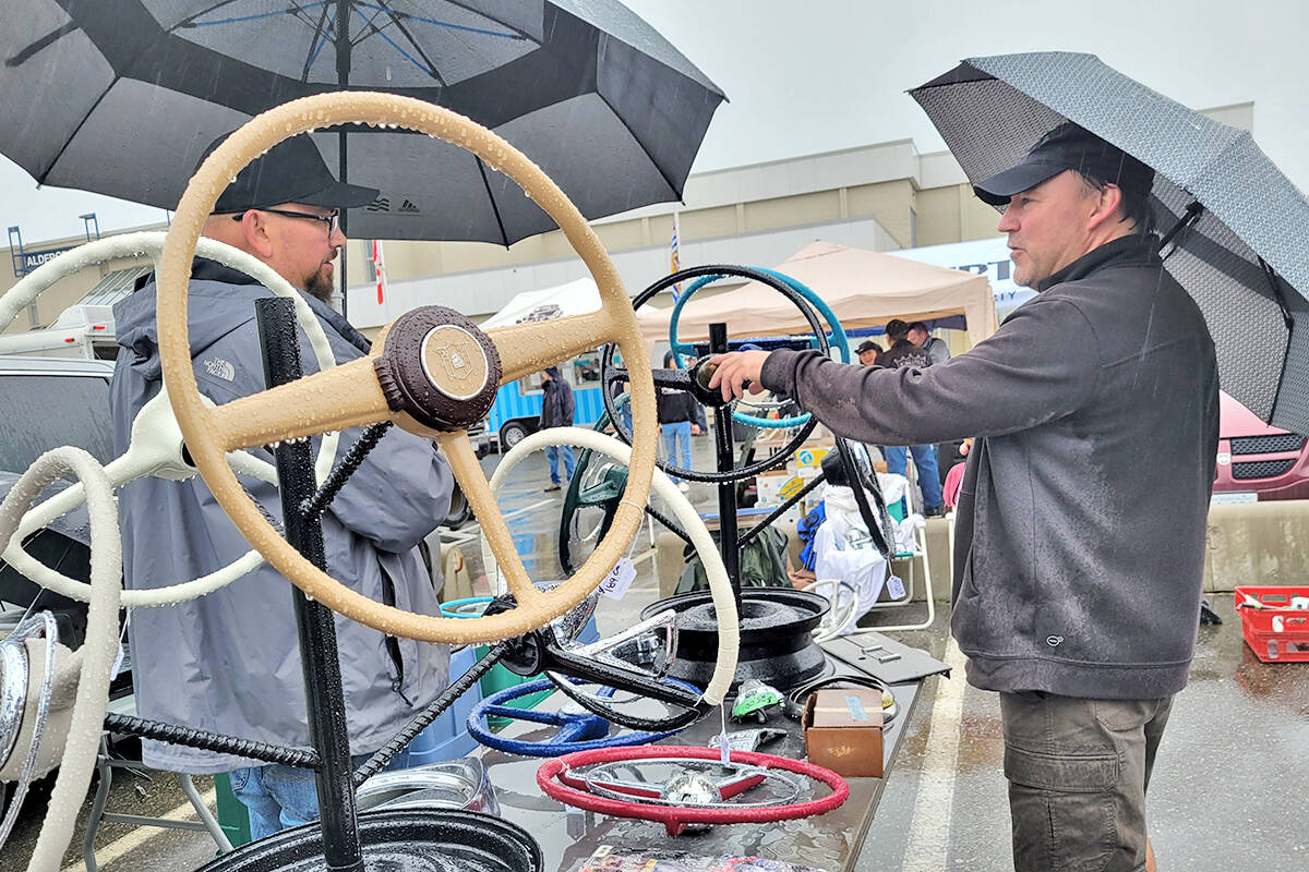 Clay Grant (right) from North Delta discussed price for one of his antique steering wheels as the Good Times Cruise-In swap meet and car corral got underway in the parking lot of the Aldergrove Community Secondary School at 26850 29th Avenue on Sunday morning, Sept. 12. (Dan Ferguson/Langley Advance Times)