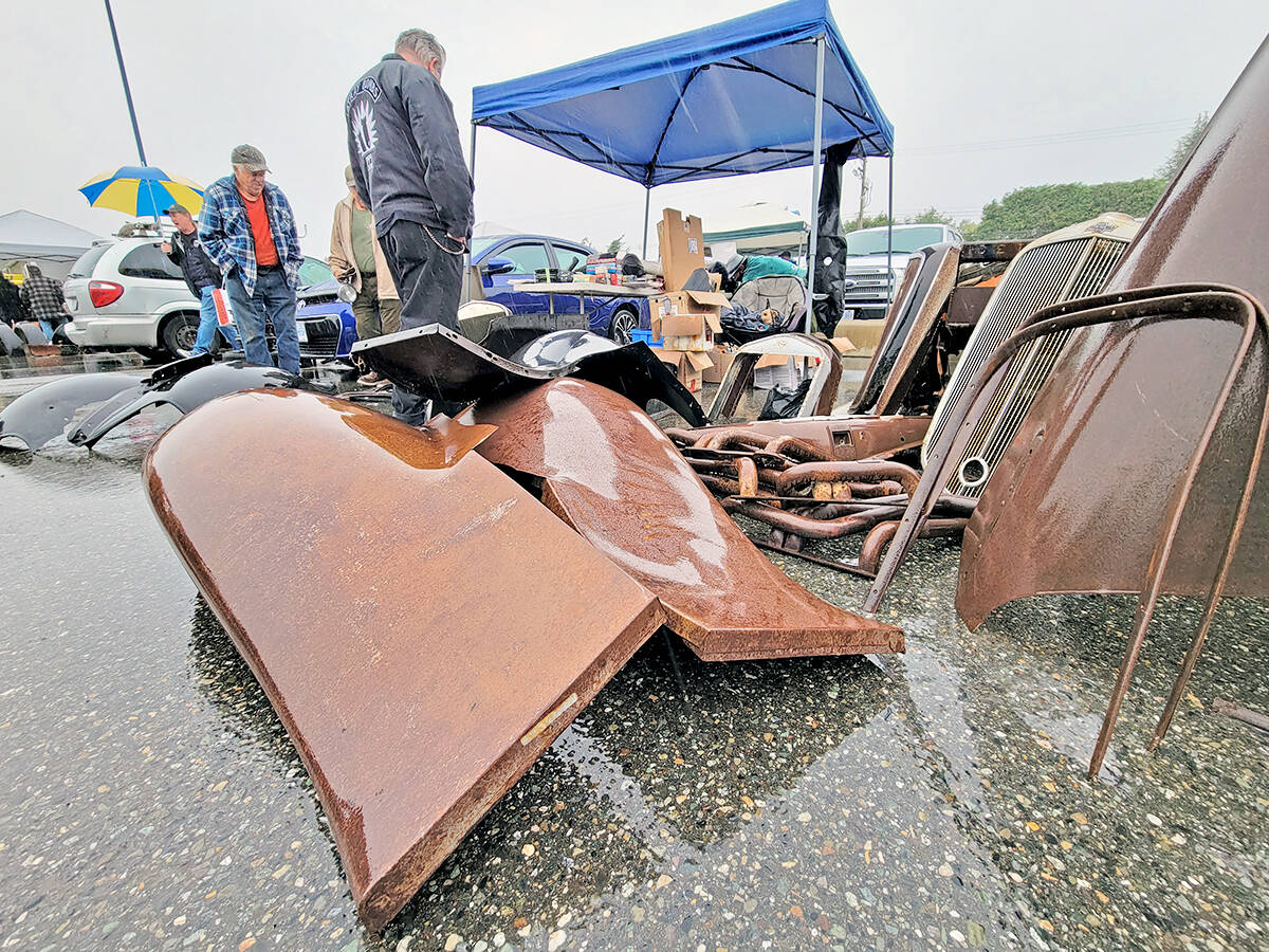 Rain was pouring down as the Good Times Cruise-In swap meet and car corral got underway in the parking lot of the Aldergrove Community Secondary School at 26850 29th Avenue on Sunday morning, Sept. 12. (Dan Ferguson/Langley Advance Times)