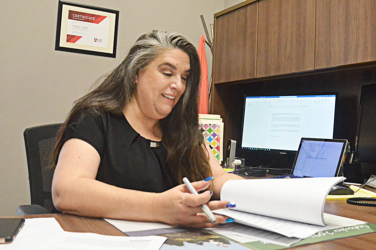 Greater Langley Chamber of Commerce CEO Colleen Clark working in her office. The Chamber is soon to celebrate 90 years. (Matthew Claxton/Langley Advance Times)