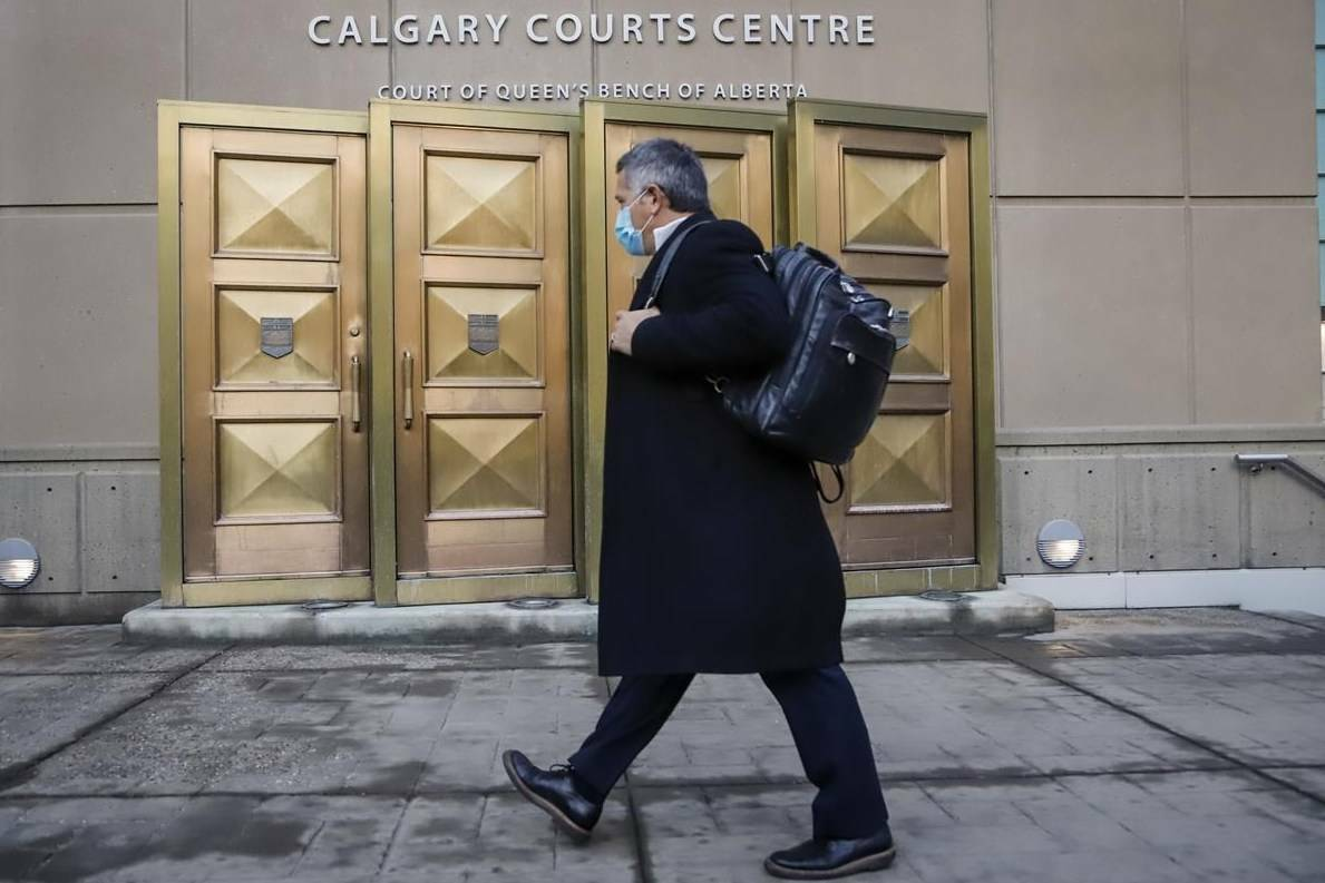 A man wears a mask as he enters the Calgary Courts Centre on Oct. 30, 2020, during the COVID-19 pandemic. THE CANADIAN PRESS/Jeff McIntosh