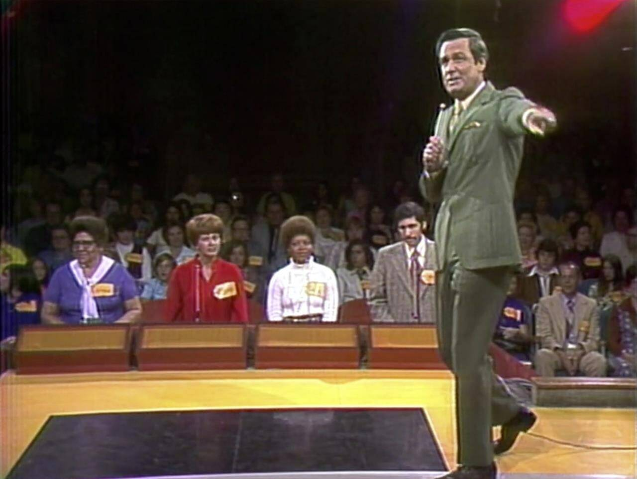 """This image released by CBS shows host Bob Barkers on first episode of """"The Price is Right"""" in Los Angeles. The longest-running game show in television history is celebrating it's 50th season. (CBS Entertainment via AP)"""