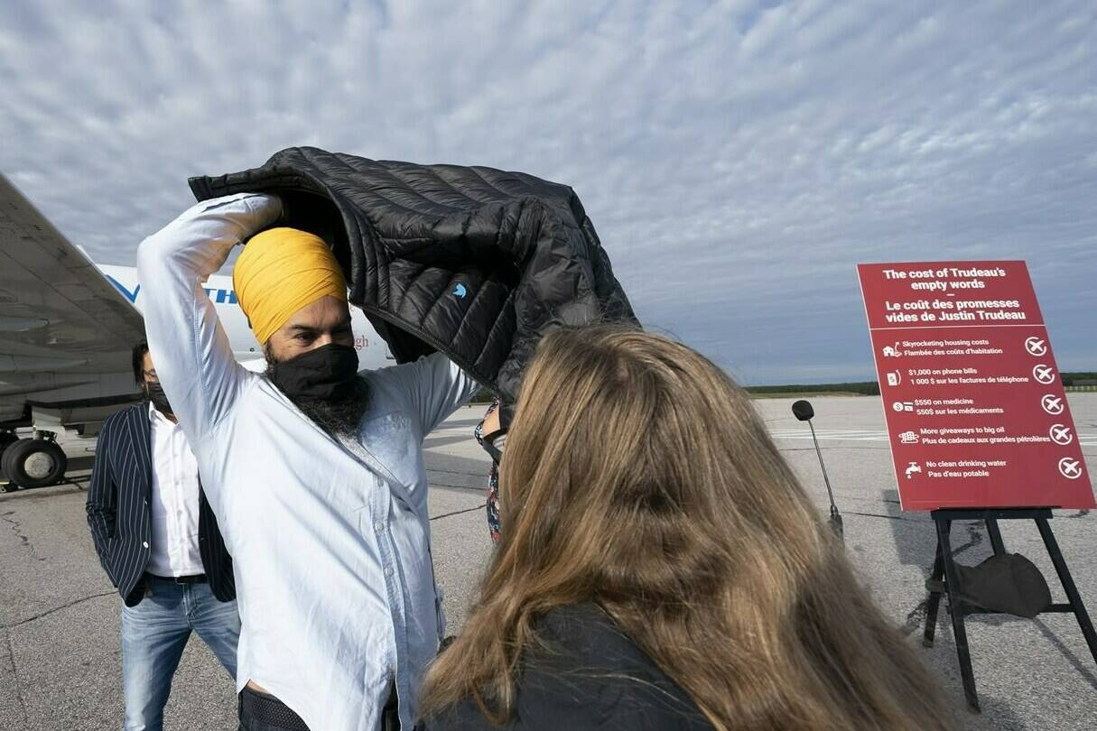 NDP leader Jagmeet Singh puts on his jacket following a morning announcement in Sioux Lookout, Ont., Monday, September 13, 2021. THE CANADIAN PRESS/Jonathan Hayward