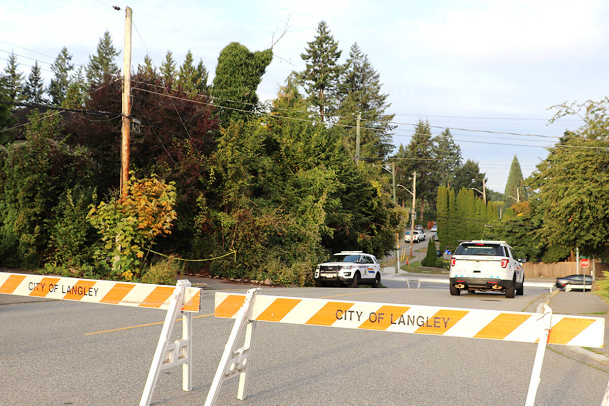 Naomi Onotera's home was behind police tape Tuesday morning, Sept. 14, 2021. (Joti Grewal/Langley Advance Times)