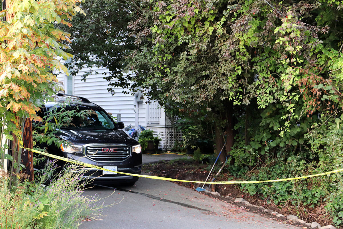 Naomi Onotera's home was behind police tape Tuesday morning, Sept. 14, 2021. An unmarked police cruiser was seen parked in the driveway. (Joti Grewal/Langley Advance Times)