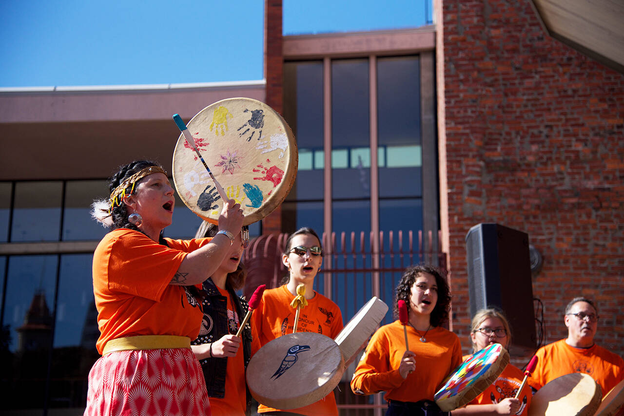A healing drum song is played during Orange Shirt Day 2019 in downtown Victoria (Black Press Media file photo)