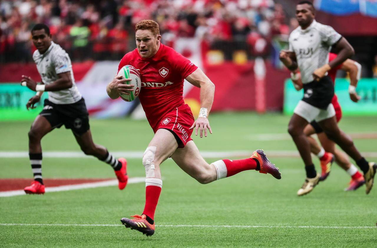 Canada's Connor Braid (6) runs the ball against Fiji during World Rugby Sevens Series action in Vancouver, B.C., on Saturday, March 9, 2019. THE CANADIAN PRESS/Ben Nelms