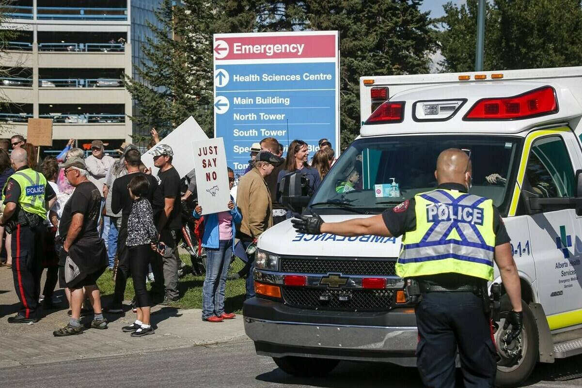 Protesters gather at the Foothills Hospital to oppose COVID-19 related public health measures in Calgary, Monday, Sept. 13, 2021. THE CANADIAN PRESS/Jeff McIntosh