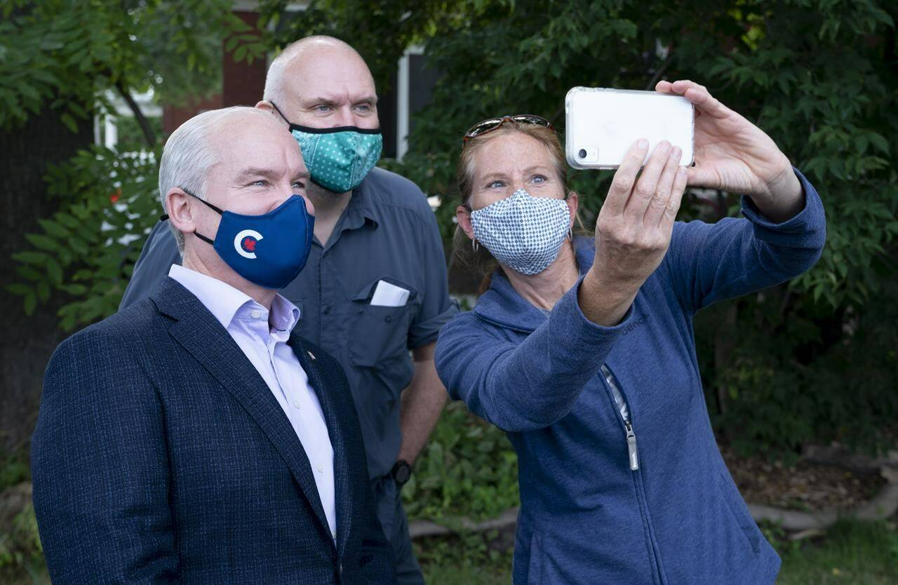 Conservative leader Erin O'Toole takes a photo with supporters during a campaign stop on Tuesday, September 14, 2021 in Russell, Ontario. THE CANADIAN PRESS/Adrian Wyld