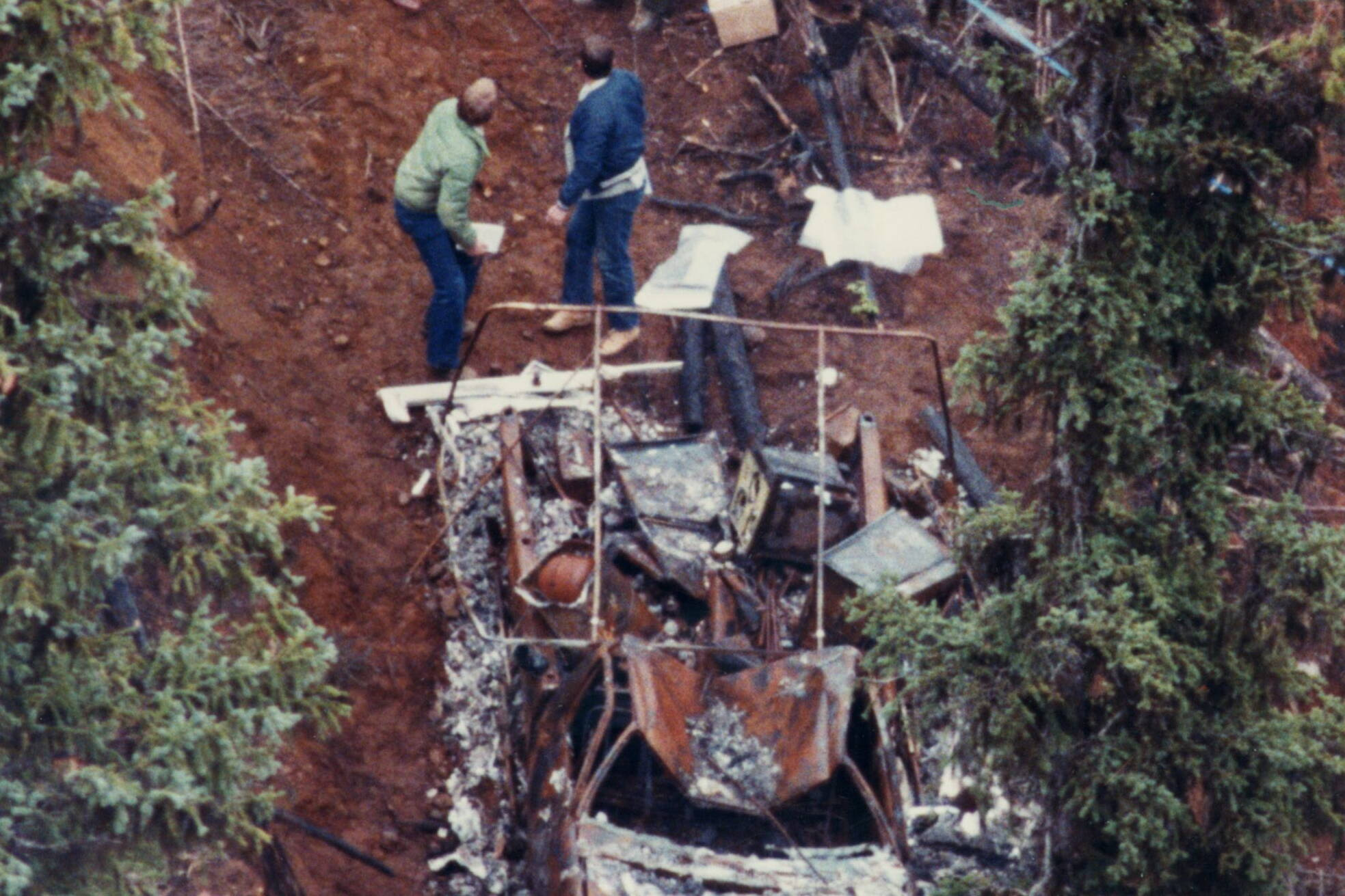 Investigators look over the burnt hulk of the Bentley's camper found just north of Clearwater. B.C. in Oct. 1983. David Ennis (formerly David Shearing) convicted of killing three generations of a BC family in a mass murder faces his first parole hearing Wednesday Oct. 22, 2008. Ennis was convicted in the deaths of six members of the Bentley- Johnson family while they were camping in Wells Gray Park, in the BC Interior, in 1982. THE CANADIAN PRESS/ Gerry Kahrmann