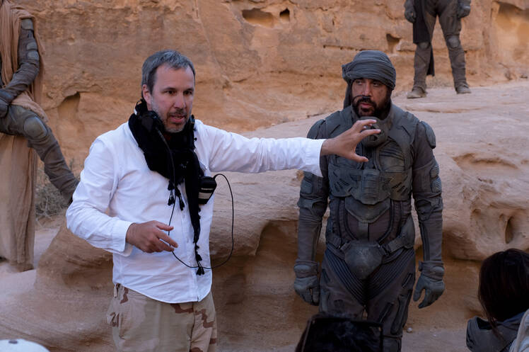 """Director Denis Villeneuve and actor Javier Bardem are shown on the set of the Warner Bros. Pictures and Legendary Pictures' action """"Dune,"""" in a handout photo. For Canadian filmmaker Villeneuve, his sprawling adaptation """"Dune"""" is more than a personal and professional accomplishment — it's part of his identity. THE CANADIAN PRESS/HO-Warner Bros. Entertainment Inc.-Chiabella James **MANDATORY CREDIT**"""