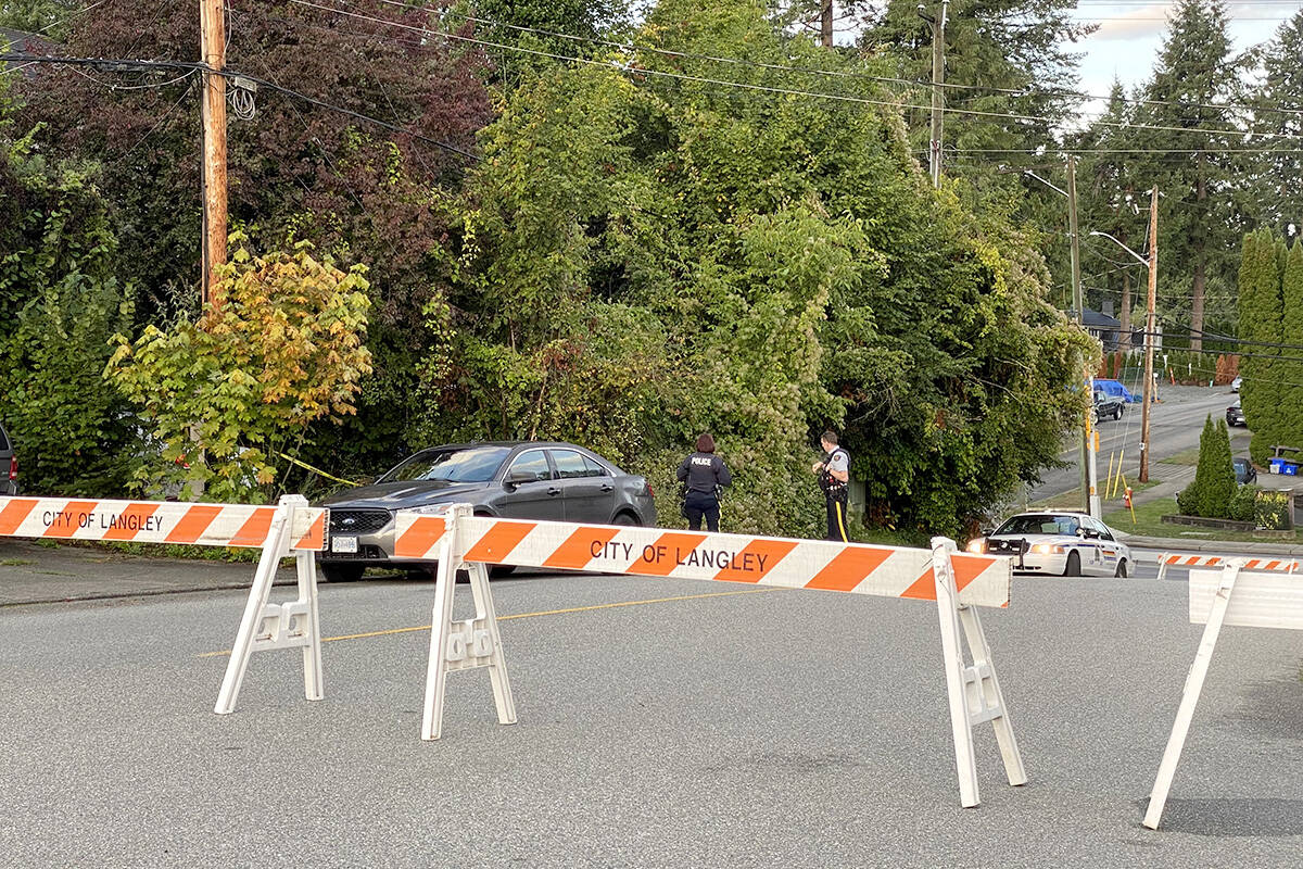 Officers can be seen outside missing Langley woman Naomi Onotera's home on Wednesday, Sept. 15, 2021. RCMP have had the Langley City home behind police tape for at least two days. Investigators were to conduct a search of the residence Tuesday or Wednesday. (Joti Grewal/Langley Advance Times)