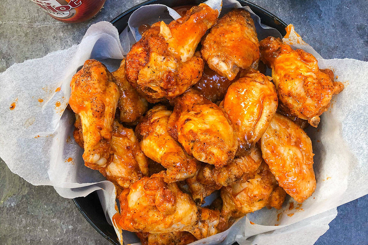 A B.C. man was fired for breaking COVID-19 protocols after a case of chicken wing-induced diarrhea was mistaken for COVID-19 by his employer. (Scott Eckersley/Unsplash photo)