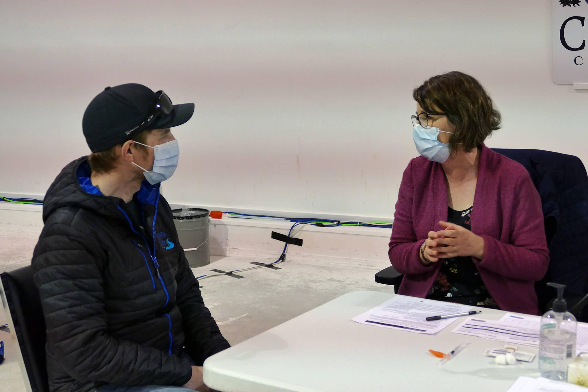 Charlie Rensby gets a COVID-19 vaccination at a clinic in Burns Lake. (Priyanka Ketkar photo/Lakes District News)
