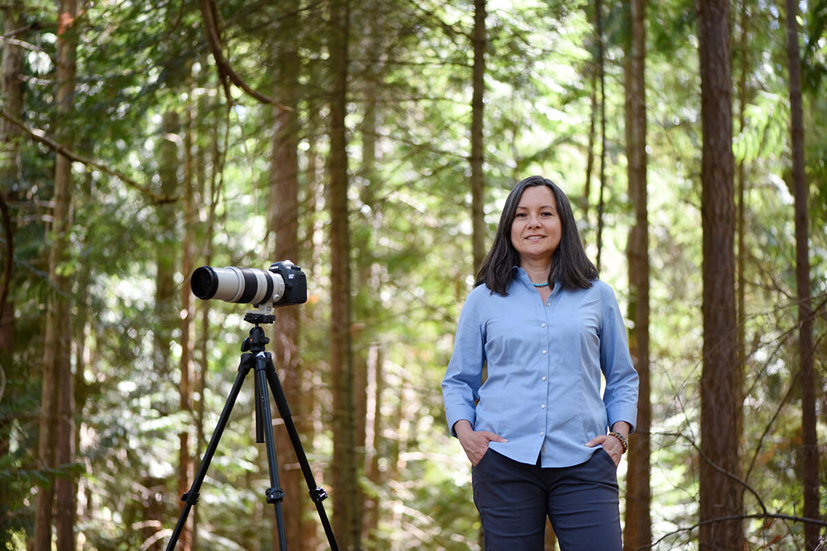 Nature and wildlife photographer Catherine Babault photographed in Moorecroft Regional park in Nanoose Bay. Don Denton photograph