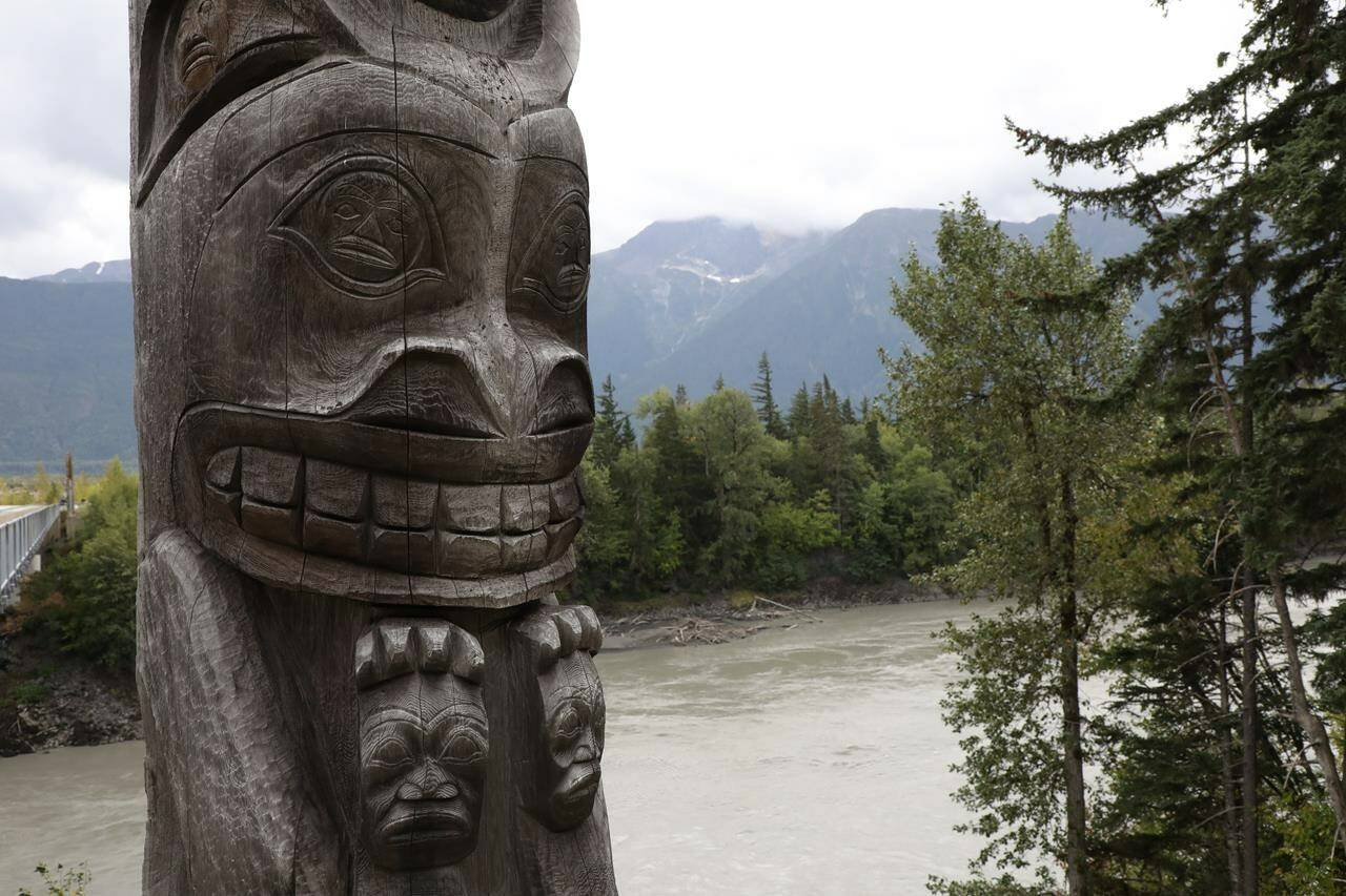 One of four totem poles on the corners of a bridge over the Nass River to Gitwinksihlkw (Canyon City) in northwestern British Columbia is seen on Saturday, Sept. 1, 2018. The Indigenous Tourism Association of Canada is making a bleak prediction about its members' ability to rapidly recover from the COVID-19 pandemic. THE CANADIAN PRESS/Colin Perkel