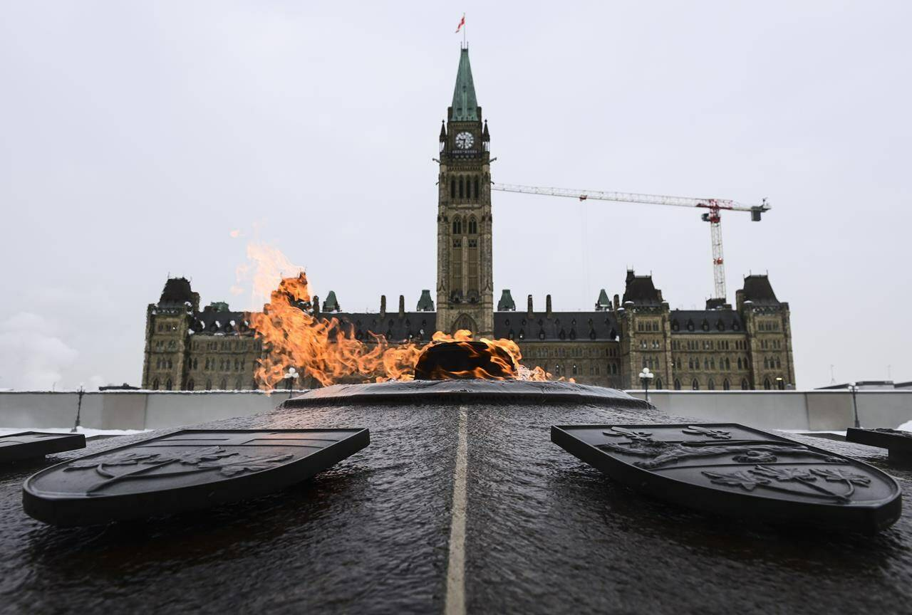 The Peace Tower is pictured on Parliament Hill in Ottawa on Monday, Jan. 25, 2021, as lawmakers return to the House of Commons following the winter break. Newly-elected MPs are to be ordered to take a training course to prevent harassment, including sexual harassment, in their offices. THE CANADIAN PRESS/Sean Kilpatrick