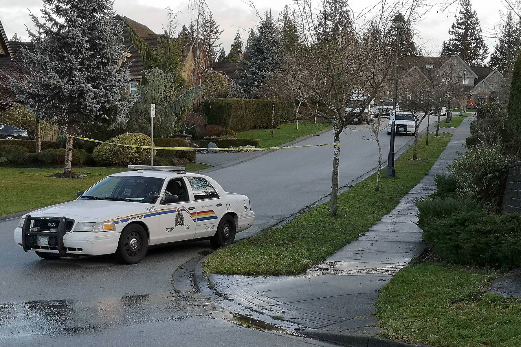 Police on the scene in South Surrey's Morgan Heights neighbourhood following the Jan. 6, 2021 shooting death of Gary Kang. (File photo)