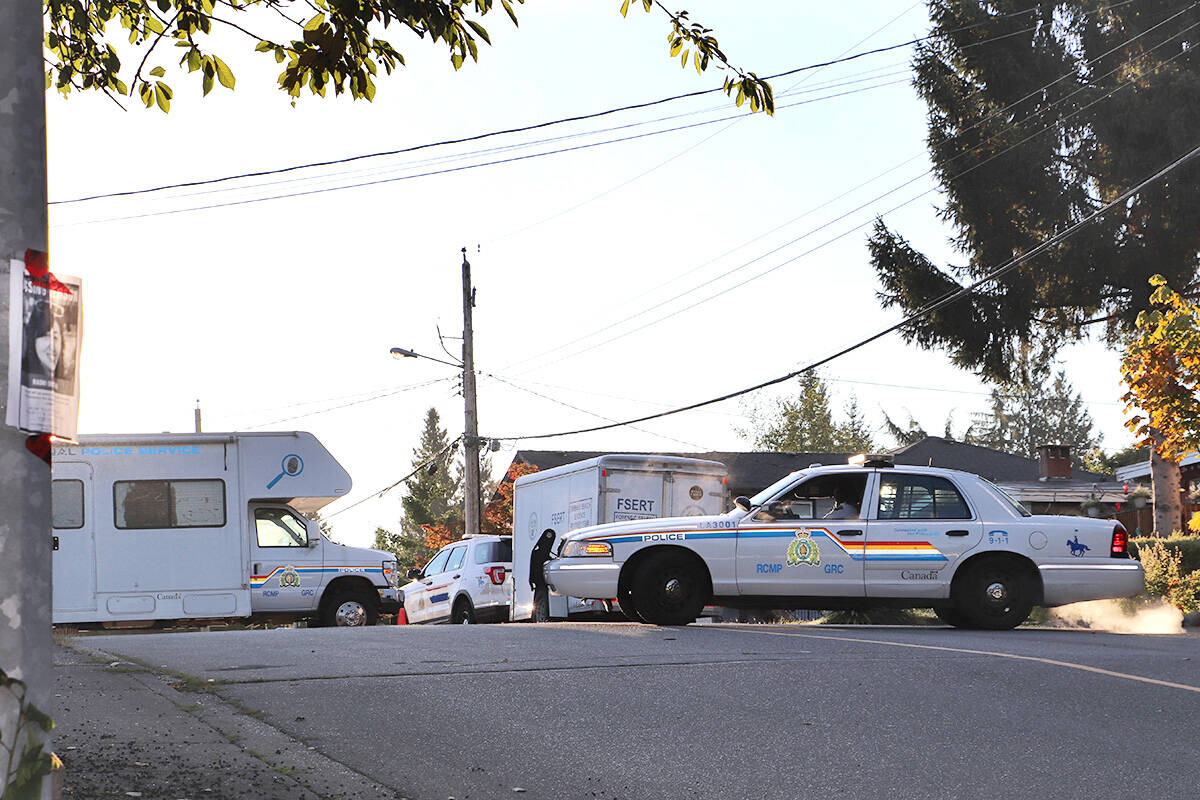 Forensic vehicles could be seen outside missing Langley woman Naomi Onotera's home on Sept. 16, 2021. Missing posters, like the one seen taped to the street light, were widely distributed throughout the community after the mother was reported missing. Homicide investigators took charge of the case on Wednesday, Sept. 15, 2021. (Joti Grewal/Langley Advance Times)