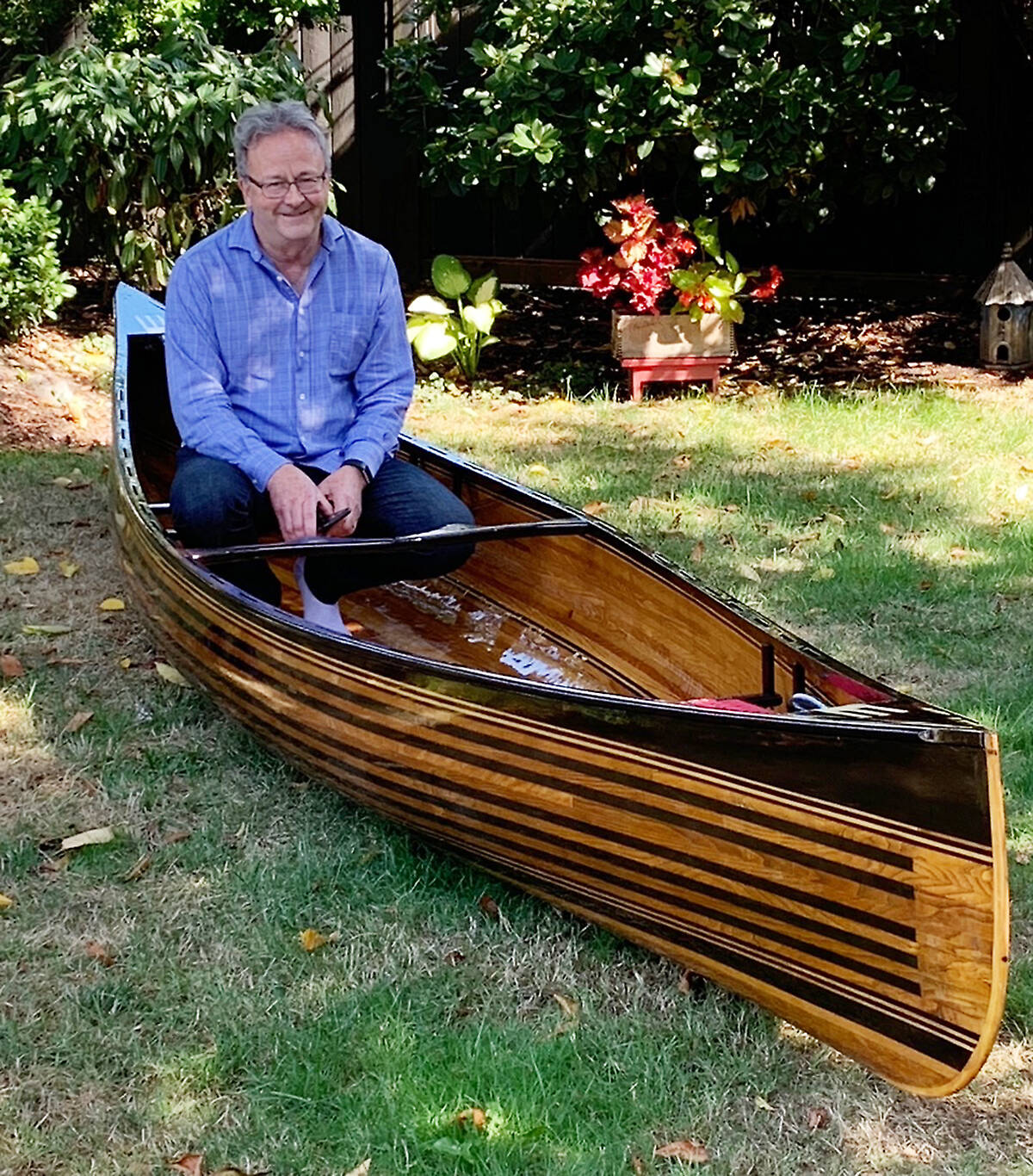 Surrey resident George Klassen sits in the canoe he made with the wood of old pianos. A piano tuner by trade, Klassen began making the canoe near the start of the COVID-19 pandemic, and finished building it this month. (submitted photo)