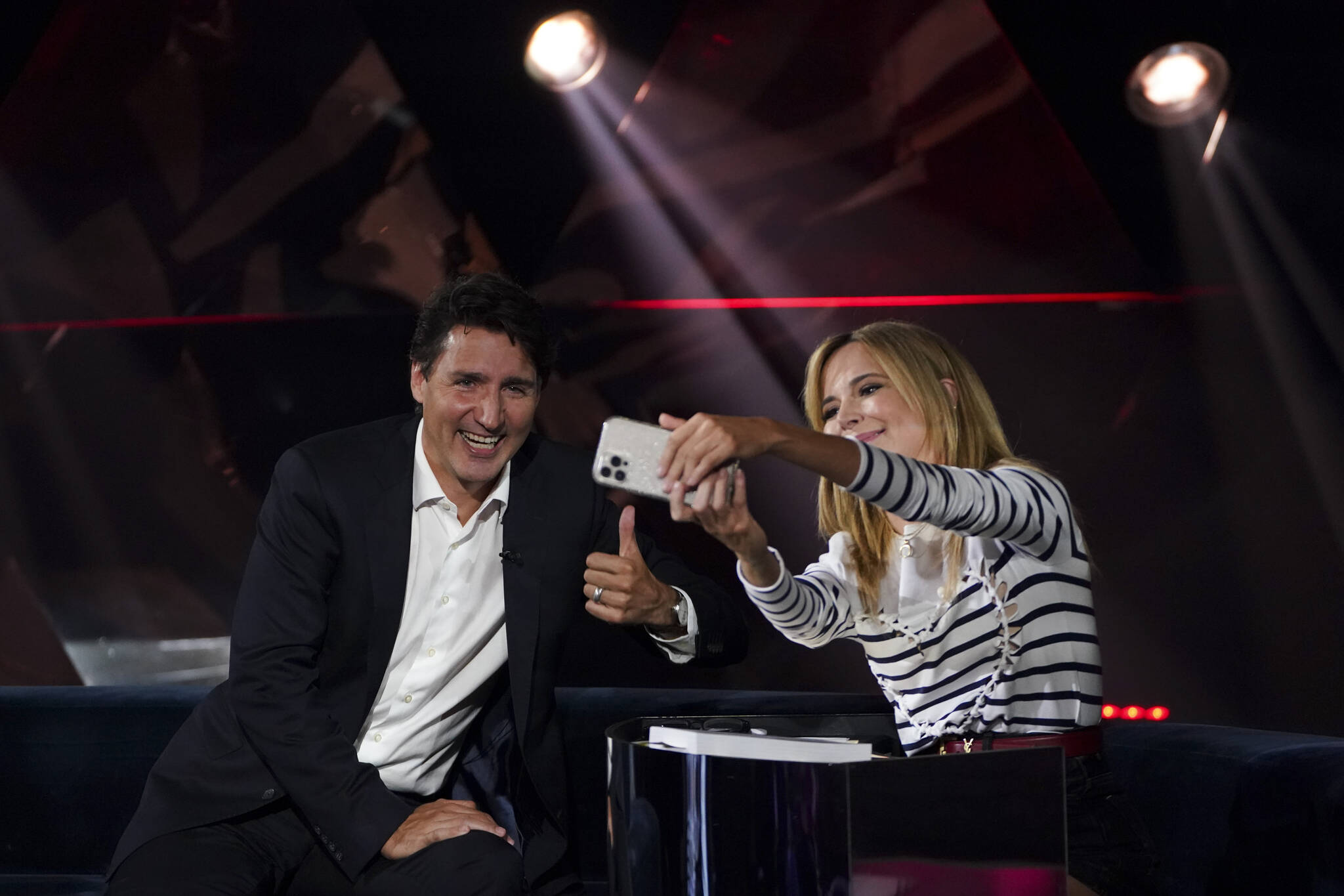 Liberal Leader Justin Trudeau talks with host Julie Snyder as he takes part in the TV show 'La Semaine des 4 Julie' in Varennes, Que. on Wednesday, Sept. 15, 2021. THE CANADIAN PRESS/Sean Kilpatrick