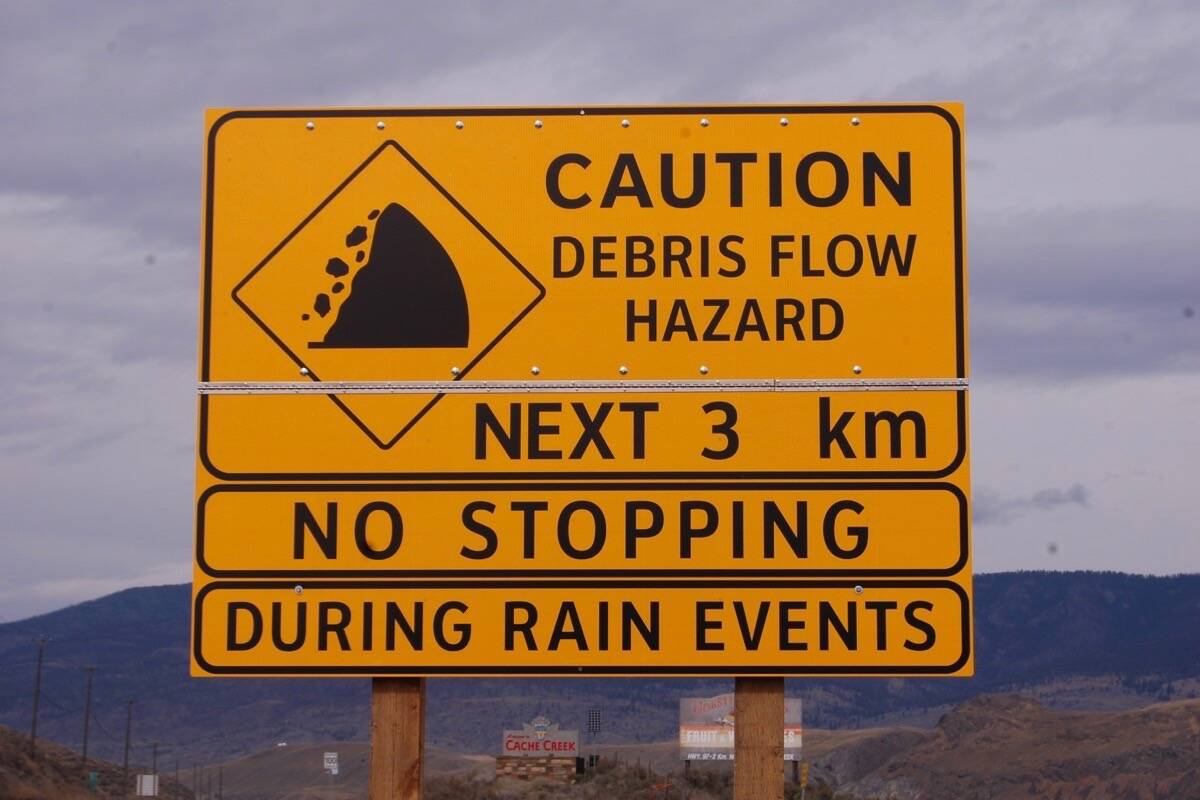 Rainfall event sign on Highway 1 near Cache Creek that went up in the wake of the 2017 wildfire season. (Photo credit: Barbara Roden)