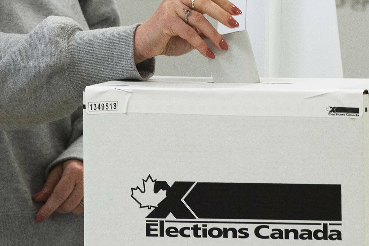 A voter casts their ballot in the advance polls, Friday, September 10, 2021 in Chambly, Que. Canadians will vote in a federal election Sept. 20th. THE CANADIAN PRESS/Ryan Remiorz