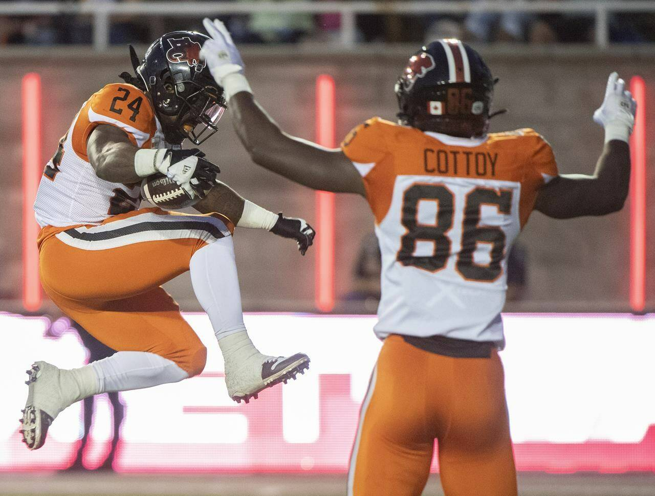 B.C. Lions James Butler (24) runs in for a touchdown during first half CFL football action against the Montreal Alouettes in Montreal, Saturday, September 18, 2021. THE CANADIAN PRESS/Graham Hughes
